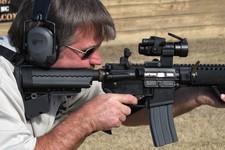 -                In this Tuesday, Feb. 5, 2013 photo, a shell is ejected as Frankie McRae fires an AR-15 semiautomatic rifle at his Range 37 gun club in Bunnlevel, N.C. McRae says U.S. Sen. Dianne Feins