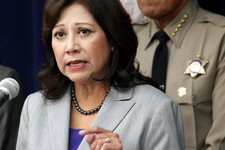 "-                FILE - In this Nov. 16, 2012 file photo Labor Secretary Hilda Solis speaks in Los Angeles. This is what ""Forward"" looks like. Fast forward, even. President Barack Obama's campaign sloga"