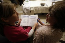-                This photo taken Jan. 30, 2013 shows patient Marlena Bechtel-Rysdam, right, from Elgin, Ore., going over home monitoring training materials with registered nurse Christina Leese at Oreg