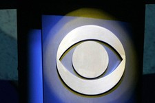 -                FILE - In this Jan. 9, 2007 file photo, a CBS Corp. logo is silhouetted in Las Vegas.  CBS reports its fourth quarter earnings on Thursday, Feb. 14, 2013. (AP Photo/Jae C. Hong, File)