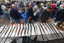 -                In this Jan. 26, 2013, photo, guns are displayed on a table on display during the annual New York State Arms Collectors Association Albany Gun Show at the Empire State Plaza Convention