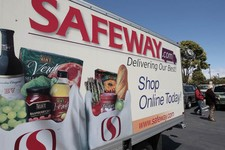 -                FILE- In this Thursday, April 26, 2012, file photo, a Safeway online shopping advertisement is shown at a Safeway store in San Francisco. Grocery store operator Safeway said Thursday, F
