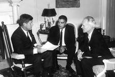 -                This photo provided by the Kennedy Library, show eting with National Urban League officials. President Kennedy (in rocking chair) meeting with National Urban League Executive Director W
