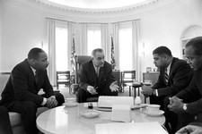 -                In this image from the LBJ Presidential Library, from left Martin Luther King Jr., President Lyndon B. Johnson, Whitney Young, James Farmer attend a meeting on Civil Rights in the Oval
