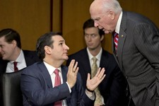 -                FILE - In this Jan. 30, 2013 file photo Senate Judiciary Committee member Sen. Ted Cruz, R-Texas, left, talks with committee Chairman Patrick Leahy, D-Vt., during a hearing about gun vi