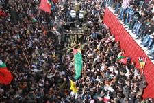 -                Palestinians attend the funeral of Arafat Jaradat in the West Bank town of Saeer, near Hebron, Monday, Feb. 25, 2013. Thousands have attended the funeral procession of a 30-year-old Pal