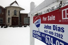 "-                In this Wednesday, Feb. 27, 2013, photo, a ""for sale"" sign is seen outside a home in Glenview, Ill., Average U.S. rates on fixed mortgages moved closer to historic lows this week, a tre"