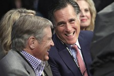 -                FILE - In this Dec. 8, 2012, file photo, former Republican presidential candidate Mitt Romney, center, joined by wife Ann, right, talks with an unidentified spectator at ringside prior