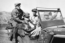 -                FILE - In this Sept. 19, 1950 file photo, Gen. Douglas MacArthur, in passenger seat wearing leather jacket, tours the newly opened Incheon Front in western Korea during the Korean War.