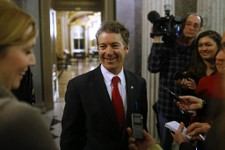 -                Sen. Rand Paul, R-Ky., leaves the floor of the Senate after his filibuster of the nomination of John Brennan to be CIA director on Capitol Hill in Washington, early Thursday, March 7, 2
