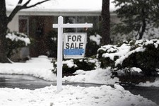 -                In this Wednesday, Feb. 27, 2013 photo, a for sale sign hangs outside a home in Glenview, Ill. Average U.S. rates on fixed mortgages were little changed the first week of March, hoverin