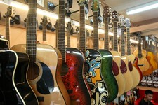 -                Guitars are on display at a musical instrument shop in Bangkok, Thailand, Friday, March 8, 2013. Delegates attending a global biodiversity conference in Bangkok this week are debating a