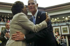 -                In this Tuesday, March 5, 2013 file photo, Florida Lt. Gov. Jennifer Carroll and Gov. Rick Scott embrace prior to his State of the State speech in the Florida House of Representatives i