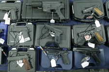 -                FILE - This March 3, 2013, file photo shows handguns displayed in Sandy, Utah. Democrats pushed an assault weapons ban through a Senate committee on Thursday, March 14, 2013, and toward