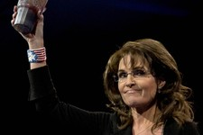 -                Former Alaska Gov. Sarah Palin holds up a 7-Eleven Super Big Gulp soda on stage at the 40th annual Conservative Political Action Conference in National Harbor, Md., Saturday, March 16,