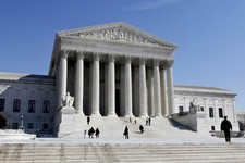 -                FILE- This March 5, 2009, file photo shows the U.S. Supreme Court building in Washington. The Supreme Court argued Monday, March 18, 2013 over whether states fighting voter fraud and il