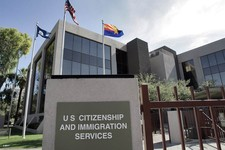 -                FILE – This Aug. 5, 2008, file photo shows the U.S. Citizenship and Immigration Services building Phoenix. The Supreme Court argued Monday, March 18, 2013 over whether states fighting v