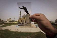 -                This Wednesday, March 13, 2013 photo shows a general view of Firdous Square at the site of an Associated Press photograph taken by Jerome Delay as the statue of Saddam Hussein is pulled
