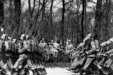 -                In this April 20, 1936 file photo, armed troops march past German Chancellor Adolf Hitler during a parade in Berlin to celebrate his birthday. As the Nazis increasingly targeted Jews an