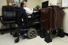-                In this photo taken Friday, March 1, 2013, Jennifer Lortie works in her Willimantic, Conn., office. Of the 29 million working–age Americans with a disability Lortie, who has limited arm