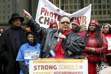 -                Karen Lewis, center, President of the Chicago Teachers Union addresses other opponents of a plan to close 54 Chicago Public Schools during a demonstration and march through Chicago's do