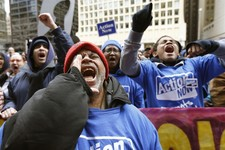 -                Member of the Chicago Teachers Union, students, and other opponents of a plan to close 54 Chicago Public Schools during a demonstrate and march through Chicago's downtown Wednesday, Mar