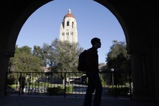 -                FILE - In this Feb. 15, 2012 file photo, a Stanford University student walks in front of Hoover Tower on the Stanford University campus in Palo Alto, Calif. Congressional inaction could