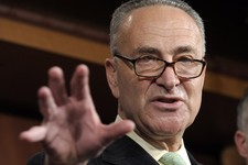 -                FILE - In this May 17, 2012 file photo, Sen. Charles Schumer, D-N.Y. gestures during a news conference on Capitol Hill in Washington. Big business and major labor unions appeared ready