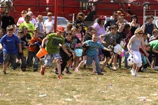 -                Kids take off at the start of the Easter Egg Hunt in search candy and eggs hidden in the playground at Eugene Bell Park in Baird, Texas, on Saturday, March 30, 2013. (AP Photo/Abilene R