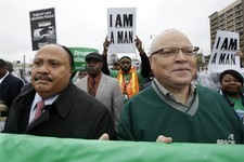-                Martin Luther King III, left, and Lee Saunders, right, president of the American Federation of State, County and Municipal Employees,  take part in a march to the National Civil Rights
