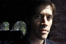 -                FILE - In this May 27, 2011 file photo American Journalist James Foley, of Rochester, N.H., poses for a photo in Boston. The parents of Foley, kidnapped in Syria more than four months a