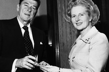-                FILE - In this April 9, 1975 file photo, former California Governor Ronald Reagan presents a silver dollar medallion to Opposition Leader Margaret Thatcher when he visited her office at