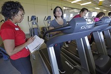 -                In this March 26, 2013 photo, Aidee Diaz, 36, center, exercises with personal trainer Angela Appleton, left, at the Rauner Family YMCA on Chicago's South Side. Diaz has lost 100 pounds