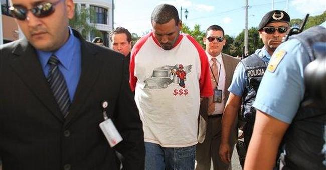 2 men held, questioned in Detroit escort slayings