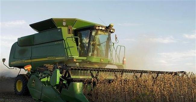 Deere posts 4Q profit as farm conditions improve
