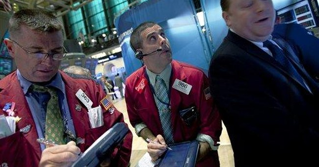 Traders on the NYSE floor react to S&P downgrade