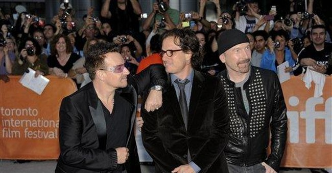 U2's Bono says he'll be a proud American on 9/11