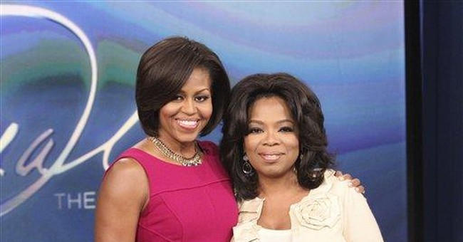 Michelle Obama honors military families on Oprah