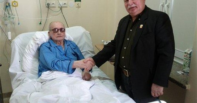 Walesa visits sick ex-communist leader in hospital