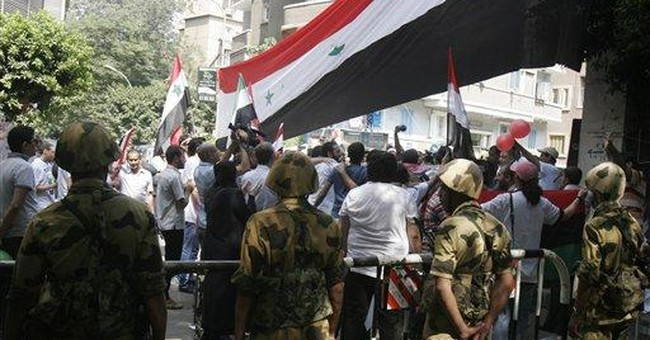 Syrian uprising showing signs of armed rebellion