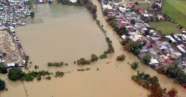 Asia reels from floods as storm whacks Vietnam
