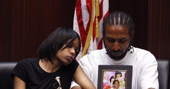 Detroit officer charged in girl's death amid raid