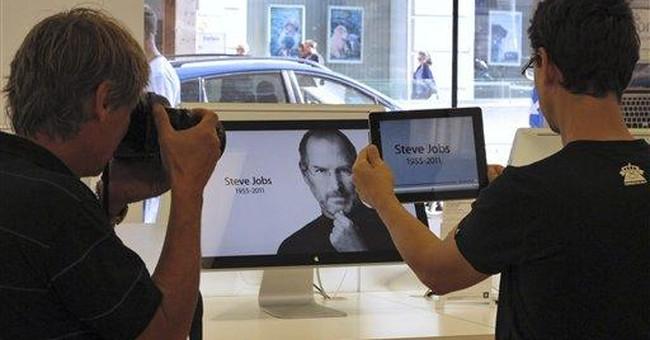 iSad: Digital titans, gadget junkies mourn Jobs