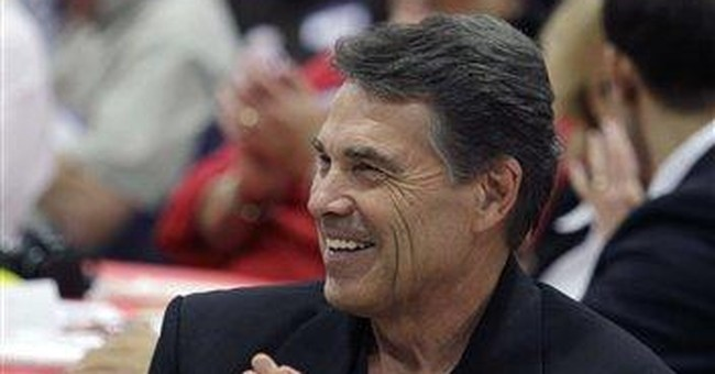 Subdued Perry tries to steady campaign in Iowa