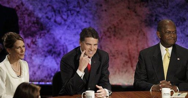 Bachmann questions Perry on spending