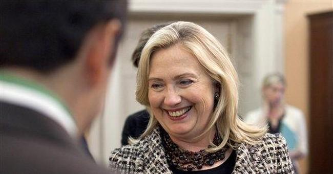 AP Interview: Clinton backs aid against Hill cuts