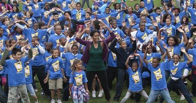 Michelle Obama takes aim at jumping jacks record