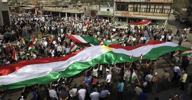 Iraqi Kurds rally over right to raise Kurdish flag