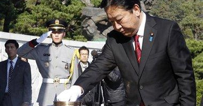 SKorea, Japan agree to expand currency swap deal