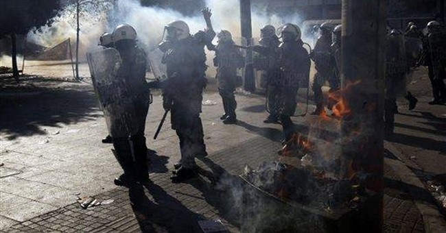 More cuts voted in Greece; riots leave 100 hurt
